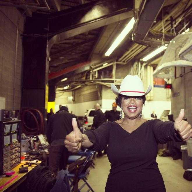 oprah white hatted in calgary cowboy hat
